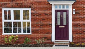 Purple composite front door installation
