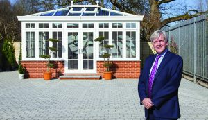 Norman in front of a patio and orangery