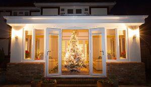 White uPVC orangery with a Christmas tree