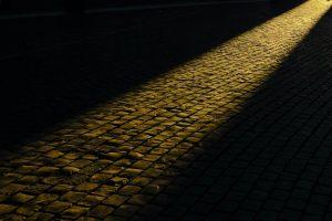 A lit cobbled path.