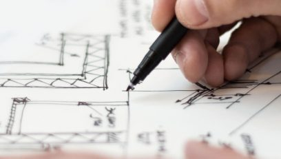 Architect drawing and writing up plans