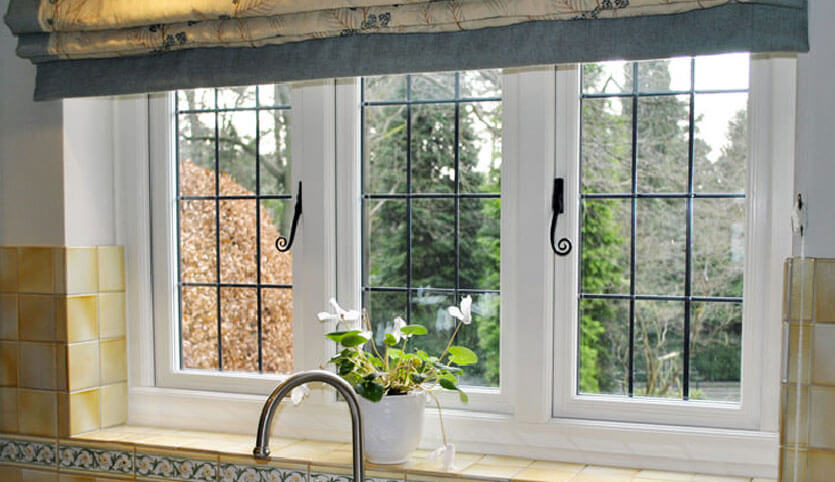 Interior view of a uPVC window with traditional heritage handles