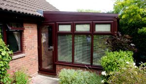 Rosewood stained hardwood lean-to conservatory