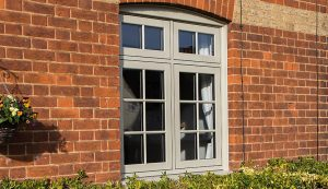 Brown uPVC flush sash window installation