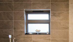 Interior view of bathroom and new aluminium casement window