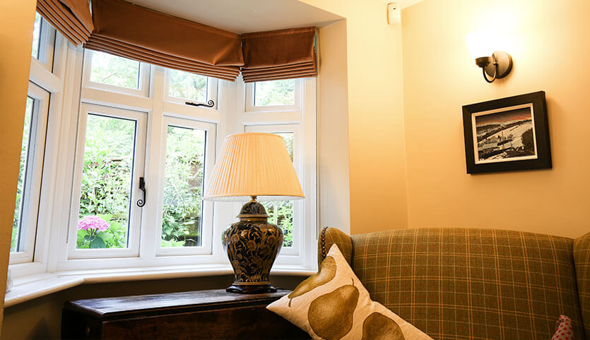 A single bay style window to replace old living room windows