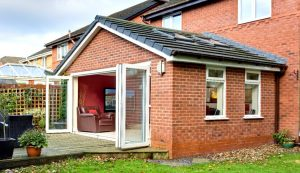 Red brick extension with a tiled roof