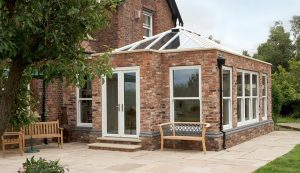 White uPVC Orangery with red brick walls