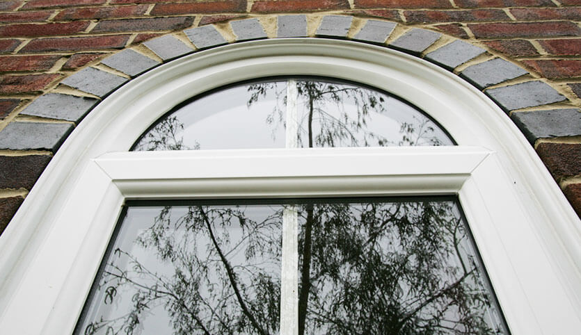 Custom arch shaped uPVC window in white