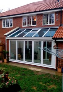 White Lean to conservatory with a glass roof