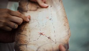 An old treasure map with 'X' marking the spot.