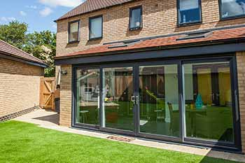 Black aluminium bifold doors installed in an extension