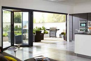 Black aluminium bifold doors installed in a kitchen