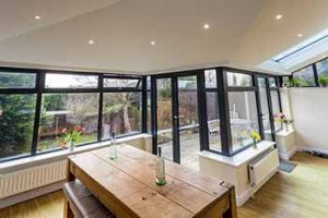 Solid roof conservatory with black frames