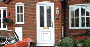 Front door with numerals, handle and letterplate