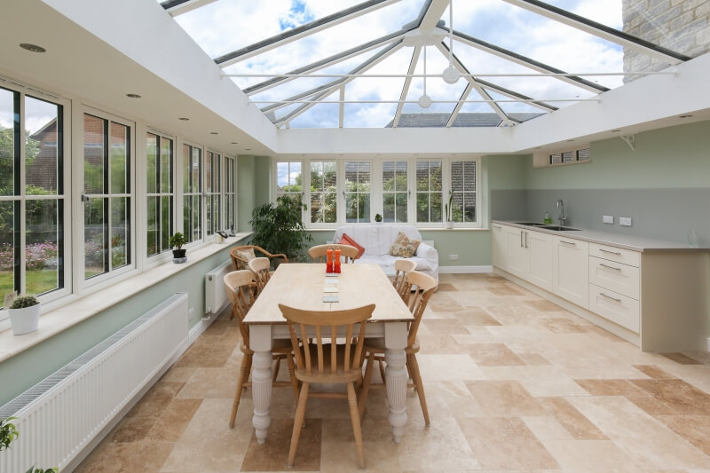 Inside a kitchen extension with glass roof.
