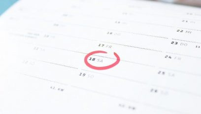 Red circle on date on wall calendar.