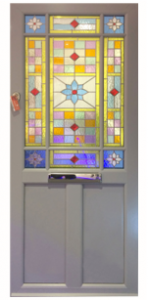 White door with stained glass.