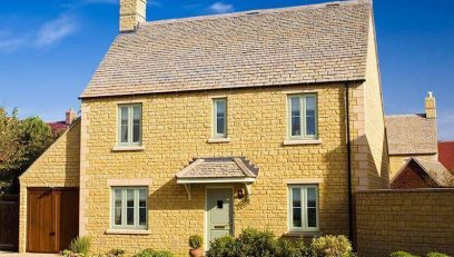 Chartwell green windows on cream stone house
